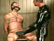 Gay  in metal restraints