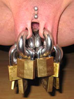 Pussy piercing of amateur slaves