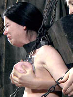 Girl shackled with heavy weight
