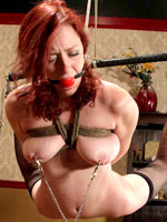 Redhead suffers in bondage