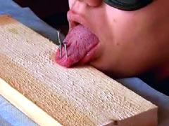Tongue nailed to board