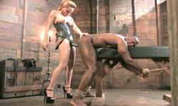 Whipping while strapon black slave