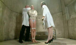 Girl in straight jacket tortured