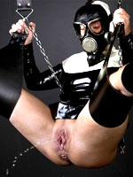 Gas mask and latex nun costume