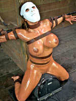 Girl tied up sitting on the fucking machine