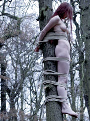 Teen tied to a tree