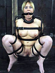 Subgirl restrained laid bare