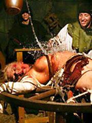 medieval torture of blonde girl