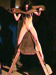 Witch tortured on wooden horse