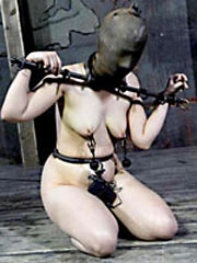 Shackled submissive in iron mask