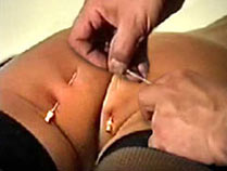 Pierced ass