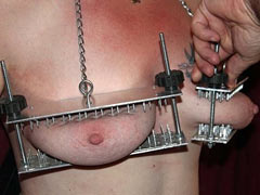 Spiked press for tits